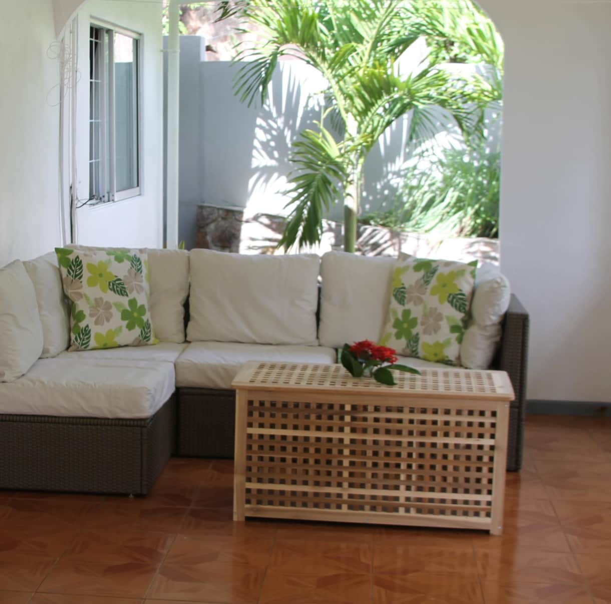 Main Terrace features rattan furniture, lounge chairs and 12 seater teak dining set