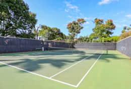 Private tennis court on property