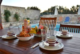 Breakfast in front of the pool