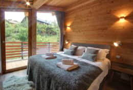 Top level double bedroom has an access to the balcony with stunning views of the mountains.