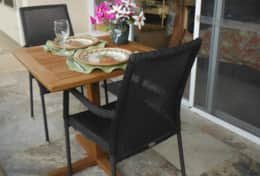 Widened lanai with teak table--enjoy meals outdoors with a view of the ocean.