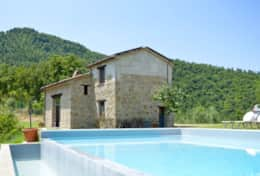 Pool and cottage at Villa Badia