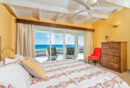 Stunning ocean view bedroom with a queen size memory foam mattress and premium bedding