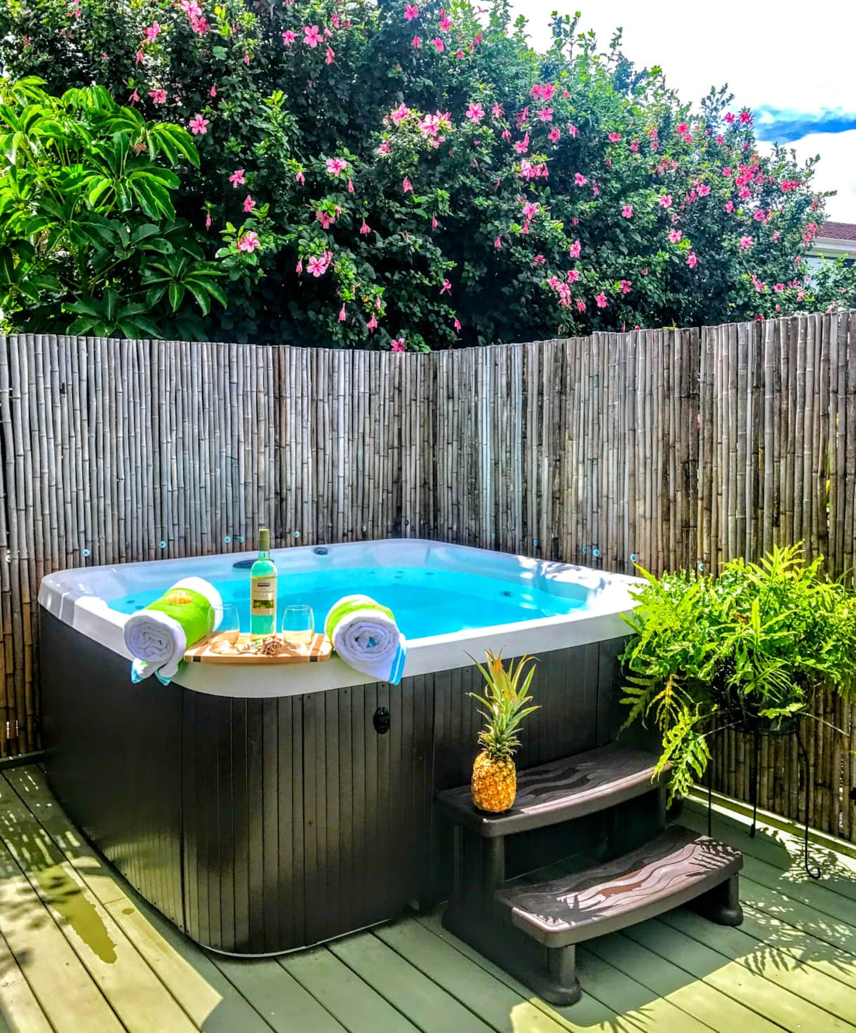 Hot tub spa on rear lanai with sunset view adjacent to the master bedroom at the Hale Makamaka.