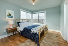 The 3rd bedroom in Unit 1 is fitted with a queen-size bed.