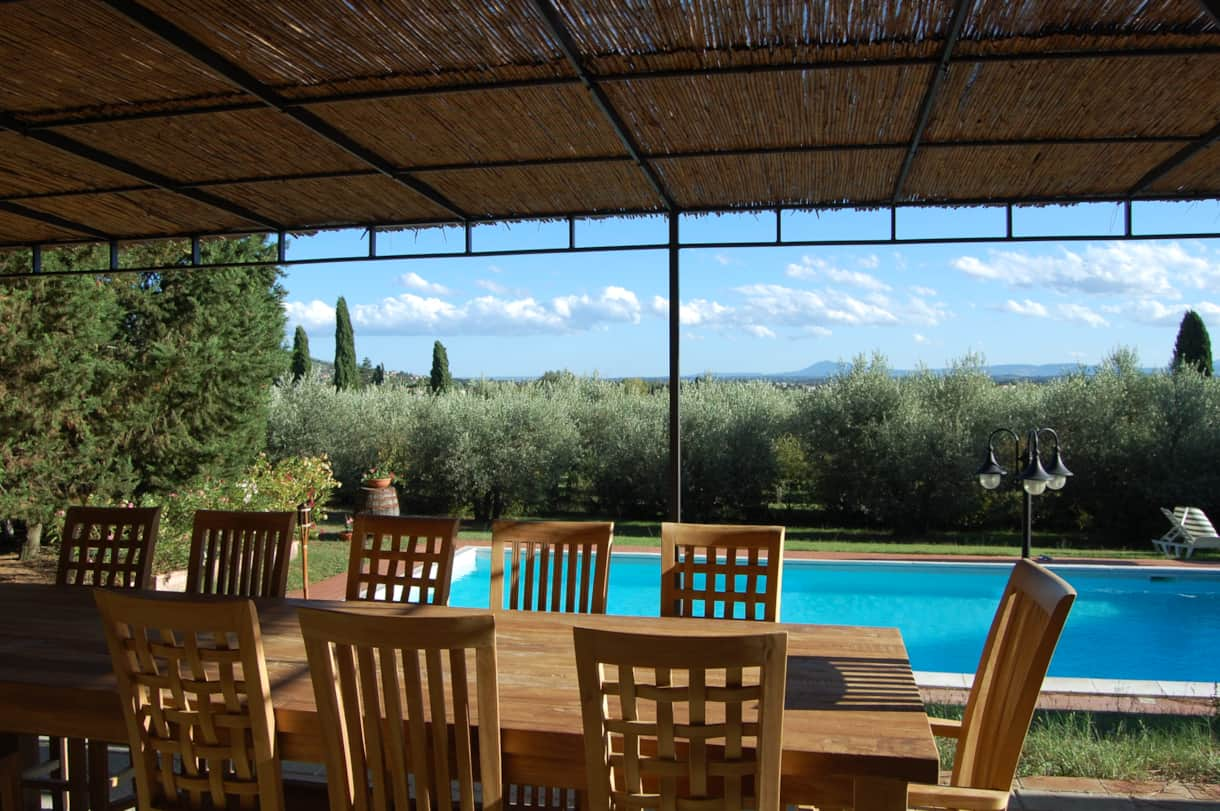 The view over table for 12, private pool and olive  grove to the hills  20 miles away