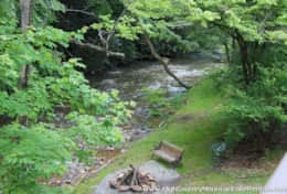HAVEN RENTALS - PICS - CREEKSIDE UNIT 3 - FIREPIT AND BENCH AND CREEK - IMG_8869