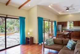 Living room with a view to the pool Casita U1 Hacienda Iguana Playa Colorado.jpg