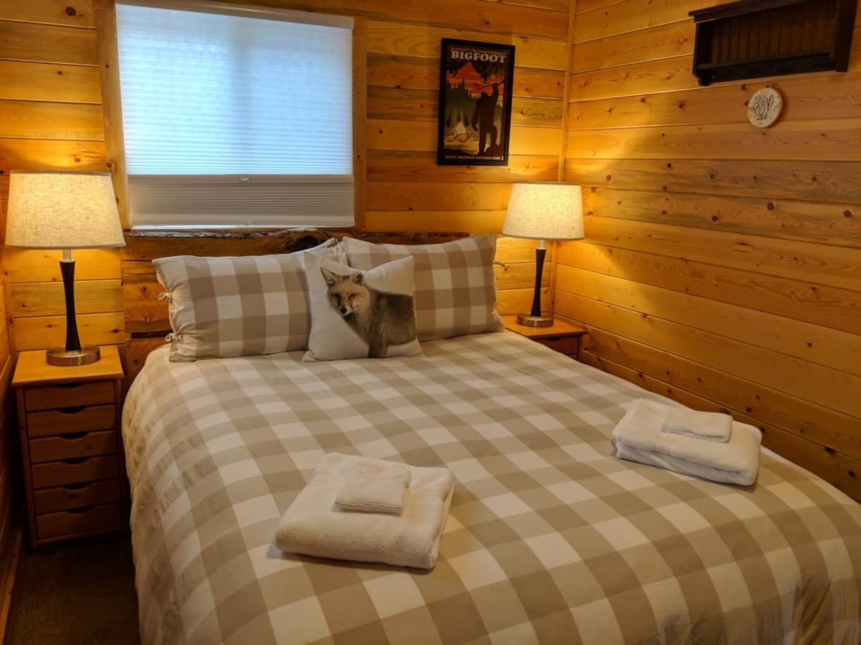 Bedroom with queen bed and bunk bed