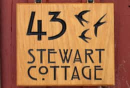K43 Stewart Cottage - Entrance Sign