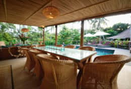 Mana Boutique common dining area overlooking the pool