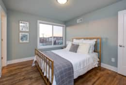 The 2nd bedroom in Unit 3 has a queen-size bed and en-suite bath.